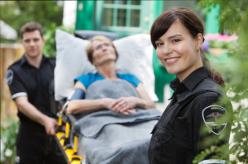 paramedics transporting an elderly woman